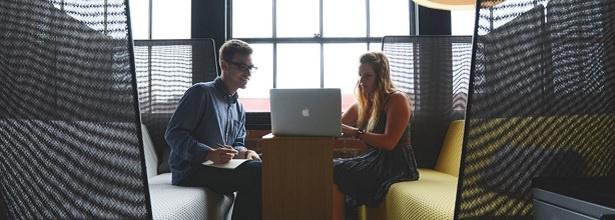 Man and woman looking at laptop
