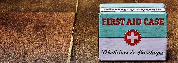 first aid box on pavement