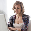 woman-in-blue-floral-top-sitting-while-using-laptop-806835-sq